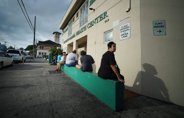 Patients wait outside the Kalihi Palama Health Clinic. Lady at right is for Anita's story, gave her the first name and declined her last name.