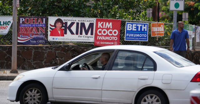 Political signs at the corner of 11th Avenue and Harding Avenue/onramp to freeway.