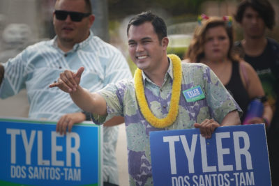 Tyler Dos Santos Tam campaigns along Wilder Street near Keeaumoku on friday afternoon.