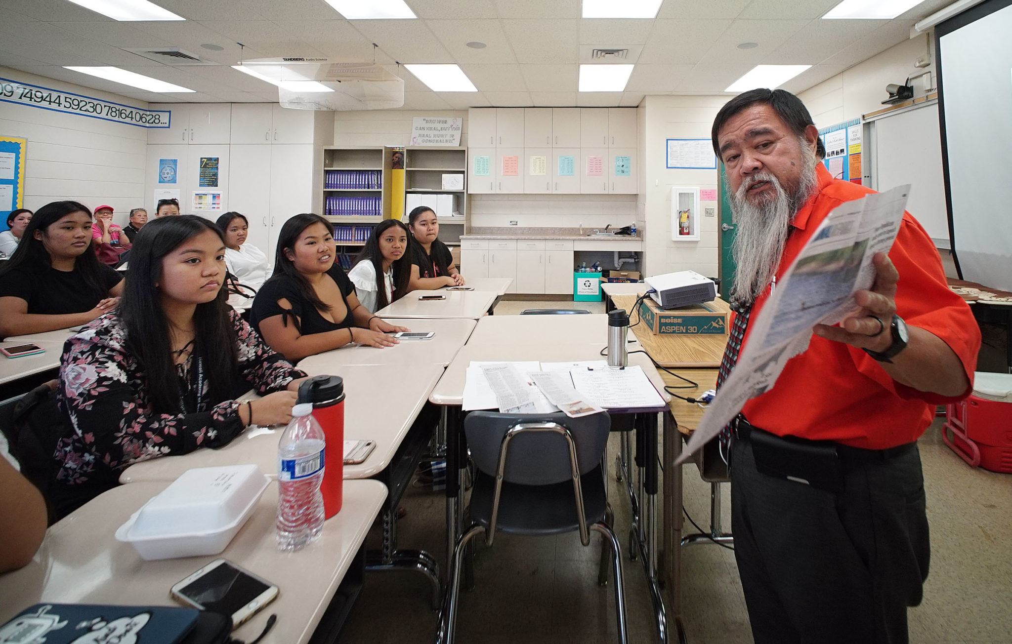 Ricardo Custodio,MD Associate Professor and Chair of Health Sciences teaches a college class at Waipahu High School.