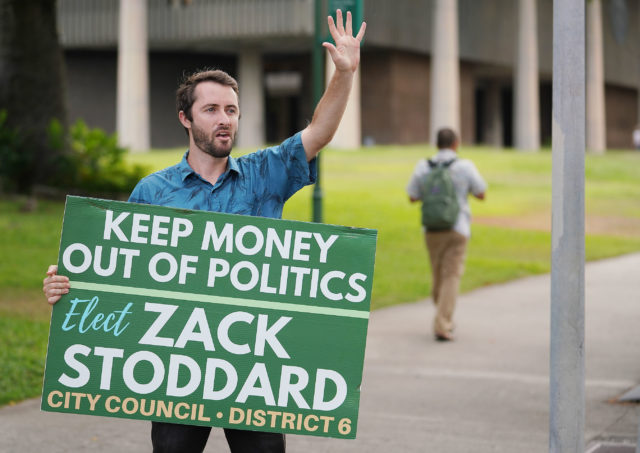 Zachary Stoddard CIty Council candidate 2018 elections stands and waves at Punchbowl and Beretania Street.
