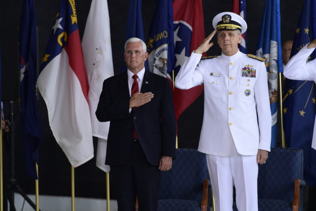 Vice President Mike Pence attends a ceremony with Commander of U.S. Indo-Pacific Command Adm. Phil Davidson marking the arrival of the remains believed to be of American service members who fell in the Korean War at Joint Base Pearl Harbor-Hickam, Hawaii, Wednesday, Aug. 1, 2018. (AP Photo/Susan Walsh)