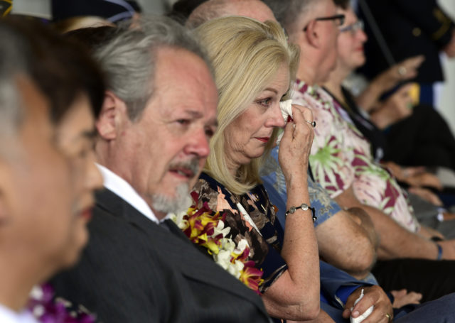 People listen at a ceremony marking the arrival of the remains believed to be of American service members who fell in the Korean War at Joint Base Pearl Harbor-Hickam in Hawaii, Wednesday, Aug. 1, 2018. North Korea handed over the remains last week. (AP Photo/Susan Walsh)
