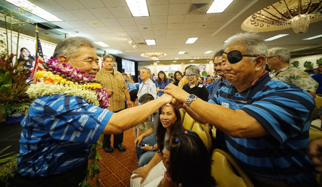 Governor David Ige greets supporters at the Pagoda Hotel.