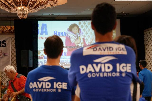 Governor Ige supporters watch Gubernatorial candidate Colleen Hanabusa speak to supporters on television. 11 aug 2018