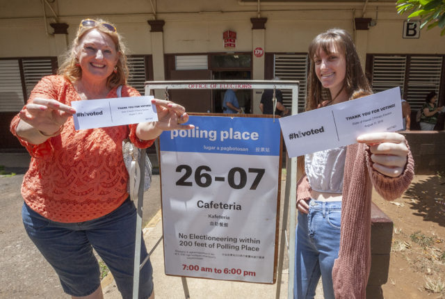 Joyce Allen, left, and her daughter Alexandria Allen, right, of Honolulu show off their voter receipt after casting their ballot for the primary elections at the Central Middle School cafeteria, Saturday, Aug. 11, 2018, in Honolulu.