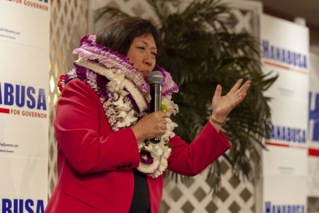 Hawaii Democratic Gubernatorial candidate Colleen Hanabusa gestures while addressing her supporters at her election night headquarters in the Japanese Cultural Center, Saturday, Aug. 11, 2018, in Honolulu.